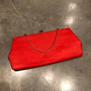 Vintage red clutch with gold strap and hardware